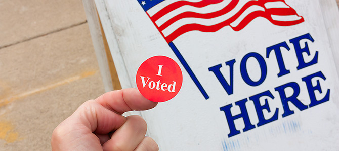 """Man at polling place with """"I Voted"""" sticker"""